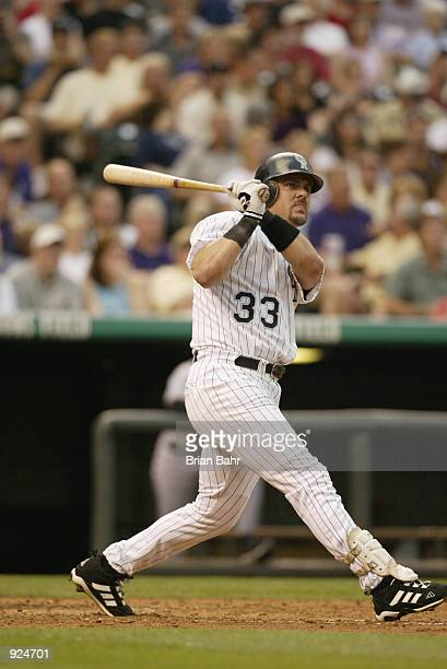 Larry Walker of the Colorado Rockies watches his home run fly to the right field bleachers against the San Francisco Giants in the second inning at...