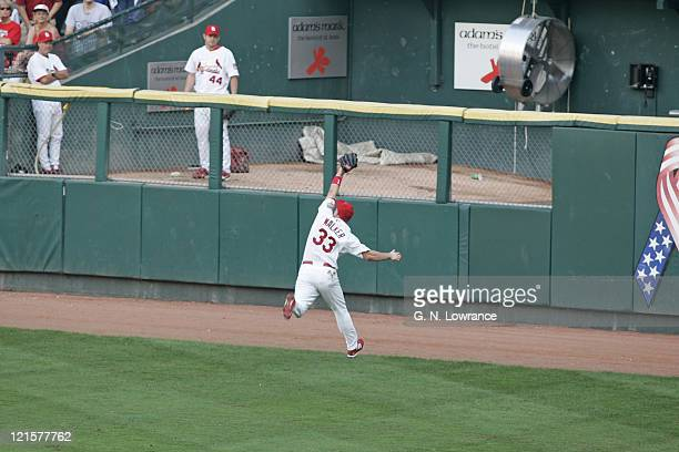 Larry Walker of the St Louis Cardinals catches a ball hit by Joe Randa in the 9th inning against the San Diego Padres during Game 1 of the National...