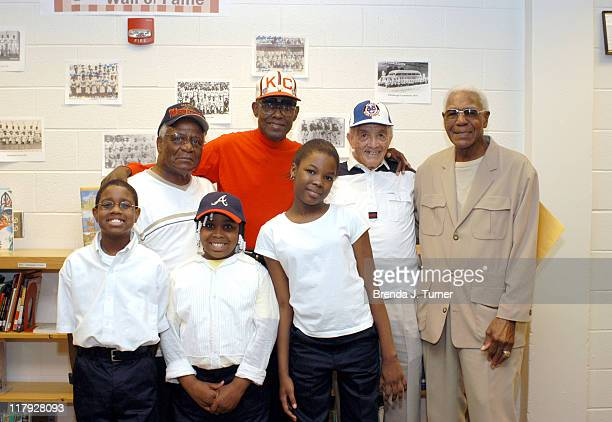 """Larry Williams, Willie Lee, James """"Red Moore and Buck O'Neil, and Larry Williams visit Braves adopted elementary school, D.H. Stanton and participate..."""