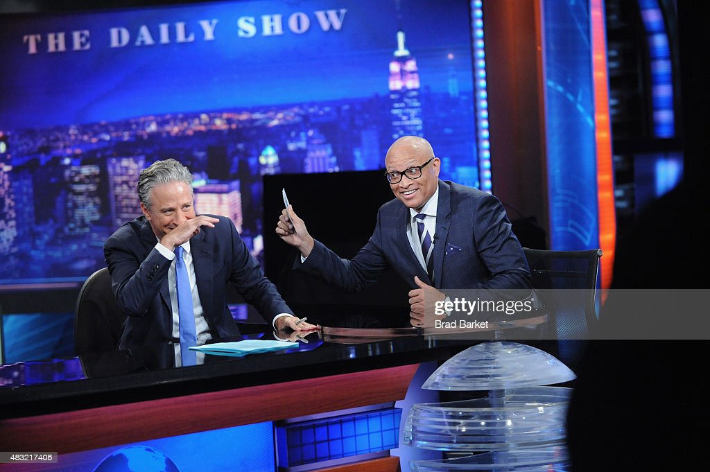 Larry Wilmore (R) and host Jon Stewart (L) appear on 'The Daily Show with Jon Stewart' #JonVoyage on August 6, 2015 in New York City.