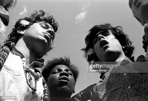 Larry Zupan Mark Hunter and Peter Pizzitola chant in Central Park circa June 1967 in New York New York