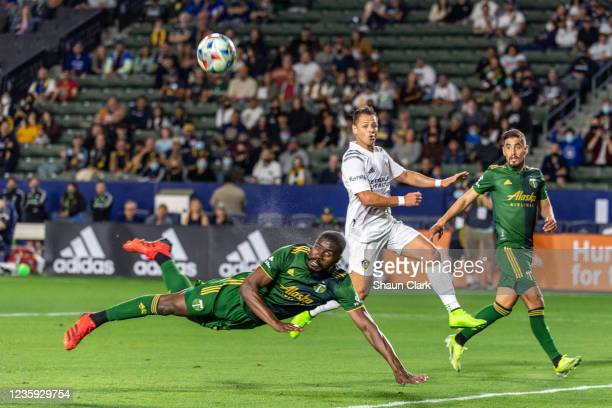 Larrys Mabiala of Portland Timbers heads the ball clear against Javier Hernandez of Los Angeles Galaxy during the game at the Dignity Health Sports...