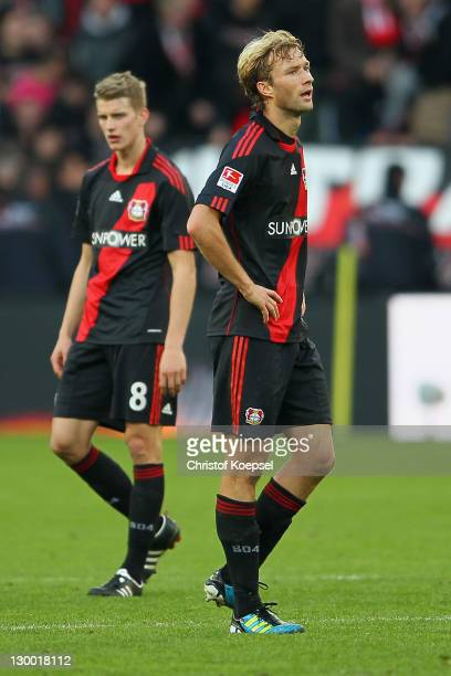 Lars Bender and Simon Rolfes of Leverkusen look dejected after losing 01 the Bundesliga match between Bayer 04 Leverkusen and FC Schalke 04 at...