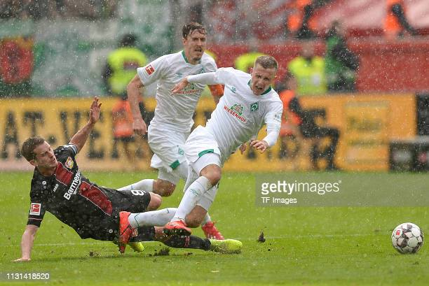 Lars Bender of Bayer 04 Leverkusen and Johannes Eggestein of SV Werder Bremen battle for the ball during the Bundesliga match between Bayer 04...