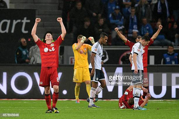 Lars Bender of Bayer Leverkusen celebrates his team's 10 victory following the final whistle during the Bundesliga match between Bayer 04 Leverkusen...