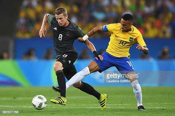 Lars Bender of Germany and Neymar of Brazil challenge for the ball during the Men's Football Final between Brazil and Germany at the Maracana Stadium...