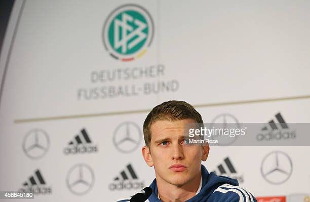 Lars Bender of Germany reacts during a press conference ahead of the EURO 2016 Group D qualifying match against Gibraltar at on November 12 2014 in...