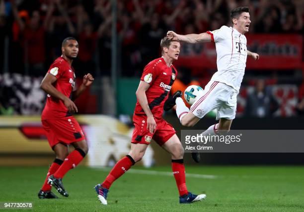 Lars Bender of Lerverkusen and Robert Lewandowski of Bayern battle for the ball during the DFB Cup semi final match between Bayer 04 Leverkusen and...
