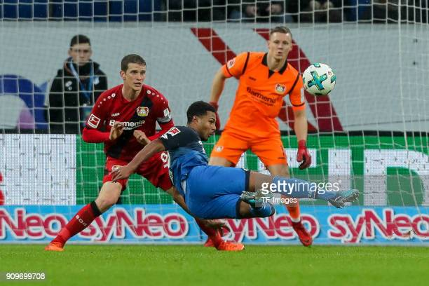 Lars Bender of Leverkusen and Serge David Gnabry of Hoffenheim battle for the ball during the Bundesliga match between TSG 1899 Hoffenheim and Bayer...