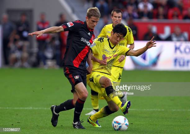 Lars Bender of Leverkusen and Shinji Kagawa of Dortmund battle for the ball during the Bundesliga match between Bayer Leverkusen and Borussia...