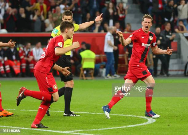 Lars Bender of Leverkusen celebrates after scoring his team's first goal with Panagiotis Retsos of Leverkusen during the DFB Cup semi final match...