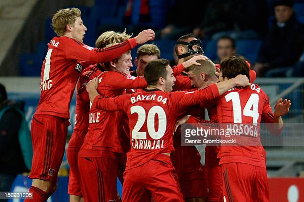 Lars Bender of Leverkusen celebrates with teammates after scoring his team's first goal during the Bundesliga match between TSG 1899 Hoffenheim and...