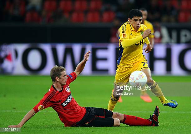 Lars Bender of Leverkusen challenges Taison of Kharkiv during the UEFA Europa League group match between Bayer Leverkusen and FC Metalist Kharkiv at...