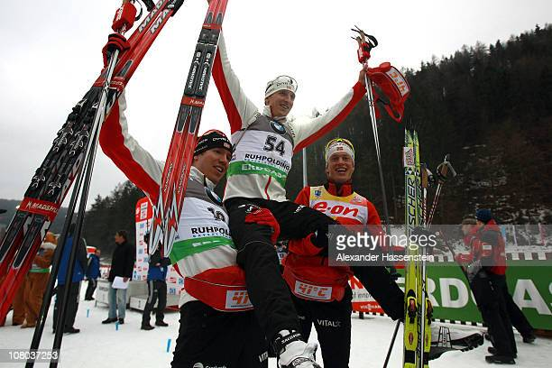 Lars Berger of Norway celebrates winning the men's 10 km sprint event with his team mates Emil Hegle Svendsen and Tarjei Boe after the eon IBU...