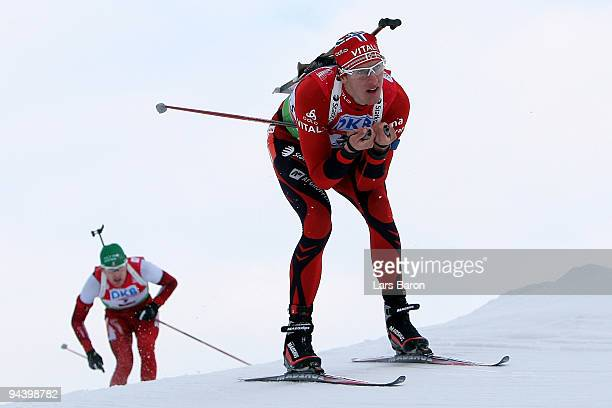 Lars Berger of Norway competes in front of Simon Eder of Austria during the Men's 125 km Pursuit in the IBU Biathlon World Cup on December 12 2009 in...