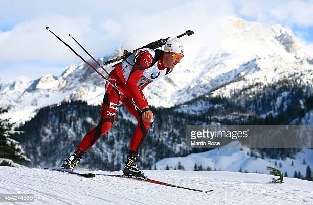 Lars Berger of Norway competes in the men's 125km pursuit event during the IBU Biathlon World Cup on December 8 2013 in Hochfilzen Austria