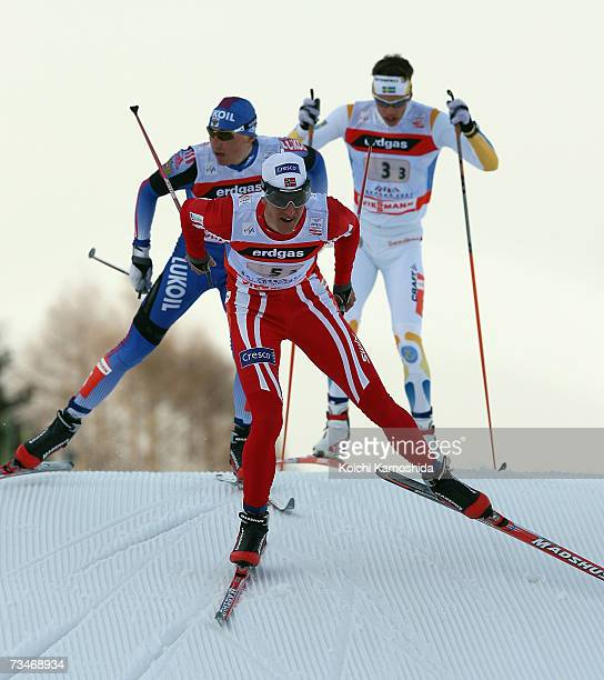 Lars Berger of Norway leads a pack of competitors in the Men's Cross Country 4 x 10 km Relay Classical and Free Event during the FIS Nordic World Ski...