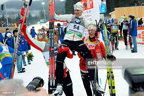Lars Berger of Norway takes 1st place Martin Fourcade of France takes 2nd place Ivan Tcherezov of Russia takes 3rd place during the IBU World Cup...