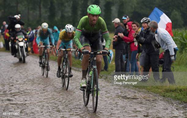 Lars Boom of The Netherlands and the Belkin Pro Cycling Team enters the final sections of cobbles en route to victory in stage five of the 2014 Le...