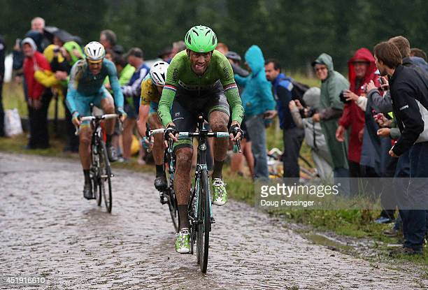 Lars Boom of The Netherlands and the Belkin Pro Cycling Team enters the final sections of cobbles en route to victory in the fifth stage of the 2014...