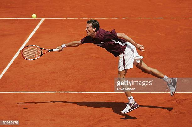 Lars Burgsmuller of Germany in action during his first round match against Rafael Nadal on the first day of the French Open at Roland Garros on May...