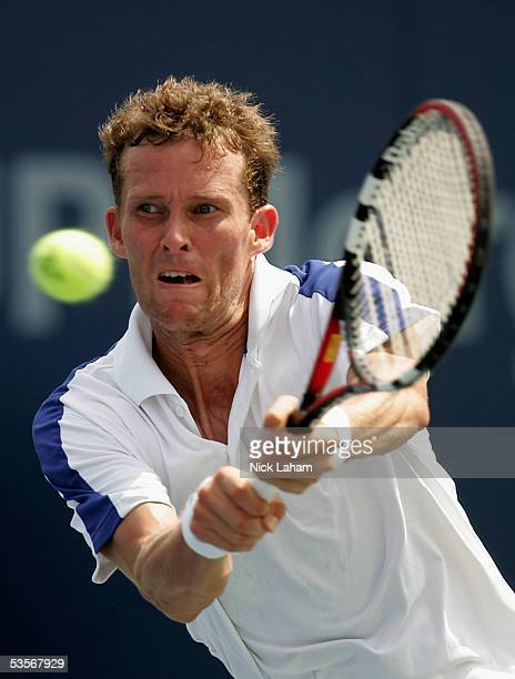 Lars Burgsmuller of Germany reaches for a shot during his match against Taylor Dent during the first round of US Open at the USTA National Tennis...