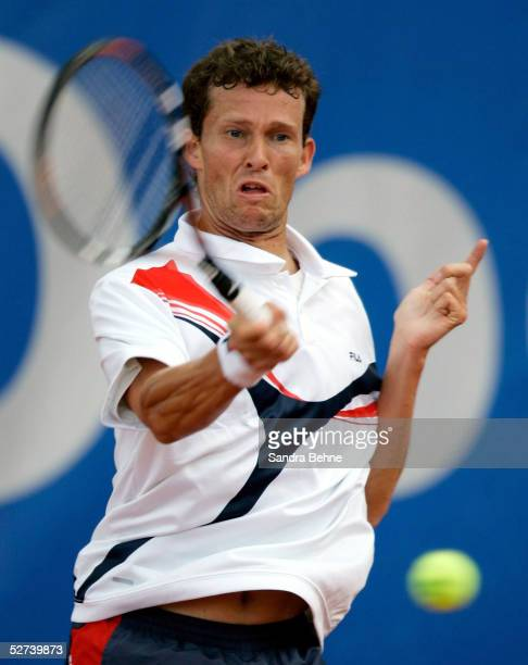 Lars Burgsmuller of Germany returns a shot to Juan Monaco of Argentina during the BMW Open tournament on April 26 2005 in Munich Germany