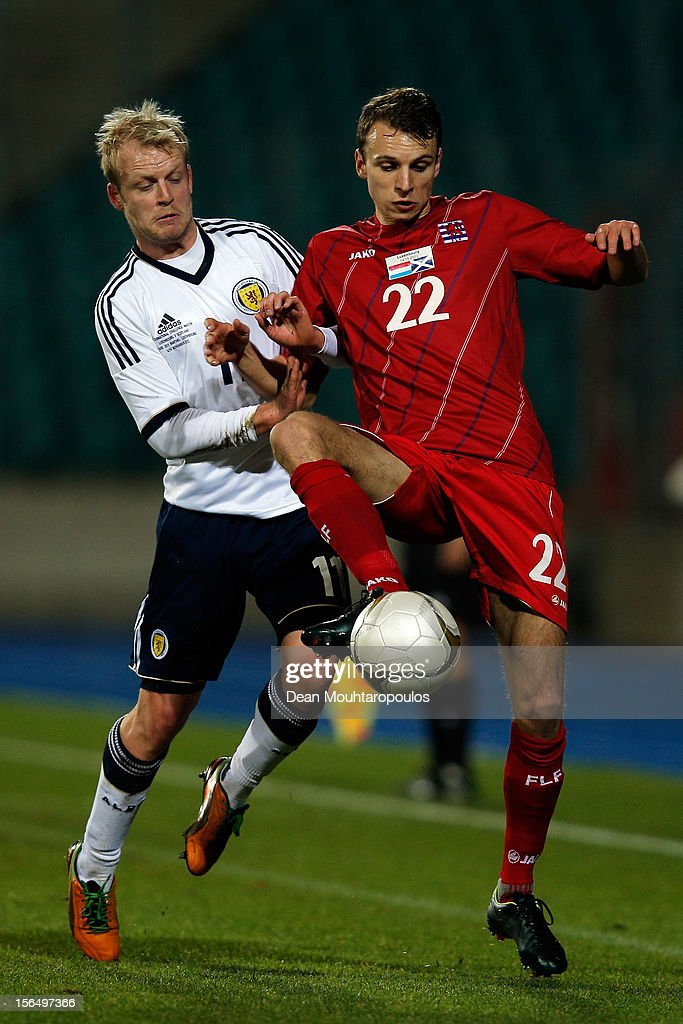 Lars Christian Krogh Gerson of Luxembourg and Steven Naismith of Scotland battle for the ball during the International Friendly match between Luxembourg and Scotland at Stade Josy Barthel on November 14, 2012 in Luxembourg, Luxembourg.