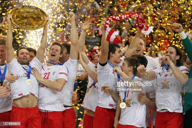 Lars Christiansen lifts the EHF tropy with Kasper Soendergaard Sarup of Denmark on the podium after winning 21-19 the Men's European Handball...