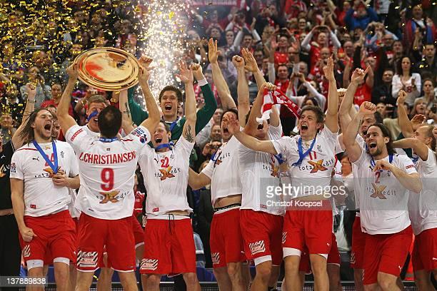 Lars Christiansen of Denmark lifts the winning trophy to his team on the podium after winning 21-19 the Men's European Handball Championship final...
