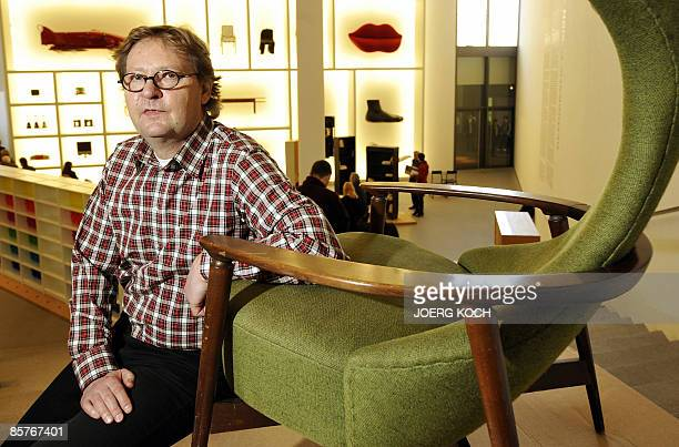 """Lars Dafnaes, leader of the design department at Swedish flat pack furniture company IKEA, poses next to a """"Cavelli"""" armchair produced in 1959 by..."""