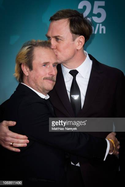 Lars Eidinger and Bjarne Maedel attend the '25 km/h' movie premiere at CineStar on October 25 2018 in Berlin Germany