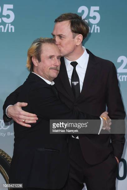 Lars Eidinger and Bjarne Mädel attend the '25 km/h' movie premiere at CineStar on October 25, 2018 in Berlin, Germany.