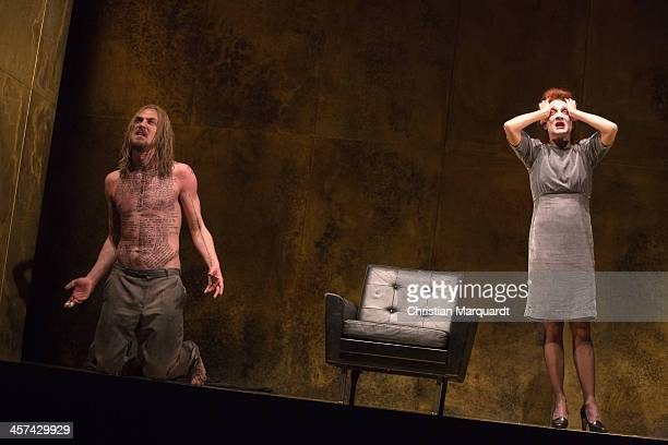 Lars Eidinger and Regine Zimmermann perform on stage during rehearsals for 'Tartuffe' at Schaubuehne Berlin on December 17 2013 in Berlin Germany The...