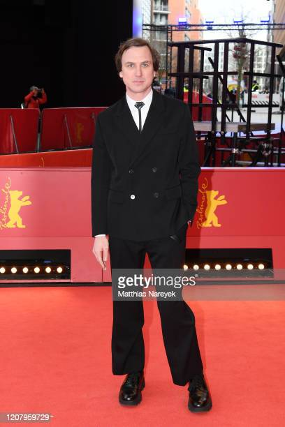 Lars Eidinger poses at the Persian Lesson premiere during the 70th Berlinale International Film Festival Berlin at Berlinale Palace on February 22...