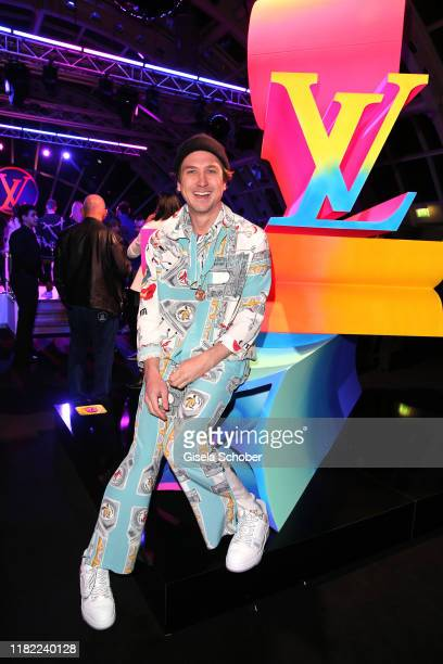 Lars Eidinger wearing a suit by Louis Vuitton during the Louis Vuitton Store opening at KaDeWe on November 12 2019 in Berlin Germany