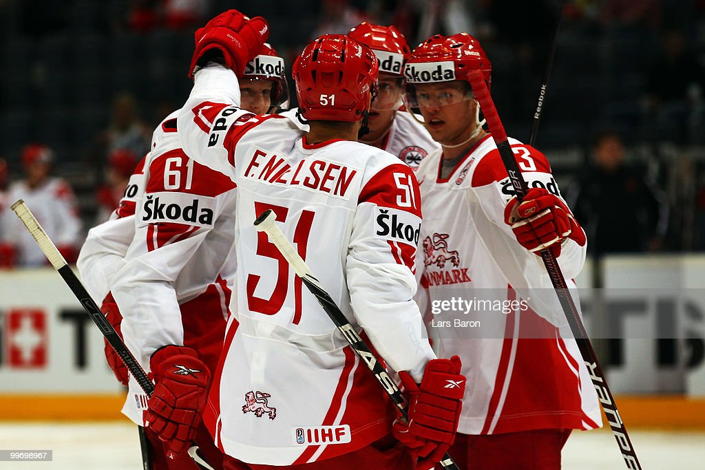Lars Eller of Denmark (#61) celebrates with team mates after scoring the first goal during the IIHF World Championship qualification round match between Belarus and Denmark at Lanxess Arena on May 17, 2010 in Cologne, Germany.