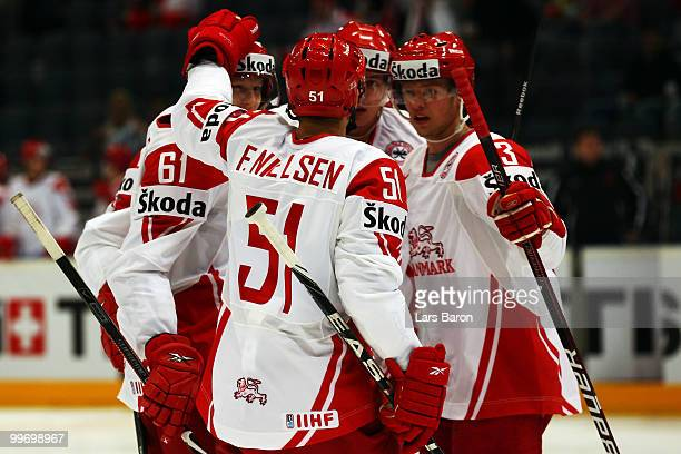 Lars Eller of Denmark celebrates with team mates after scoring the first goal during the IIHF World Championship qualification round match between...