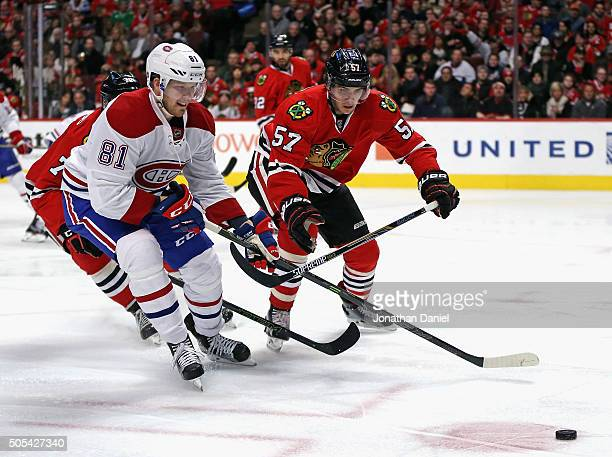 Lars Eller of the Montreal Canadiens chases down the puck with Dennis Rasmussen and Trevor van Riemsdyk of the Chicago Blackhawks at the United...