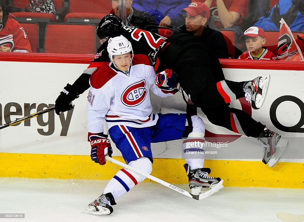 Lars Eller #81 of the Montreal Canadiens collides with Alexander Semin #28 of the Carolina Hurricanes during play at PNC Arena on March 7, 2013 in Raleigh, North Carolina. The Canadiens won 4-2.
