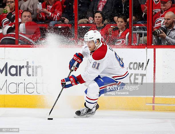 Lars Eller of the Montreal Canadiens controls the puck on the ice during an NHL game against the Montreal Canadiens at PNC Arena on April 7 2016 in...