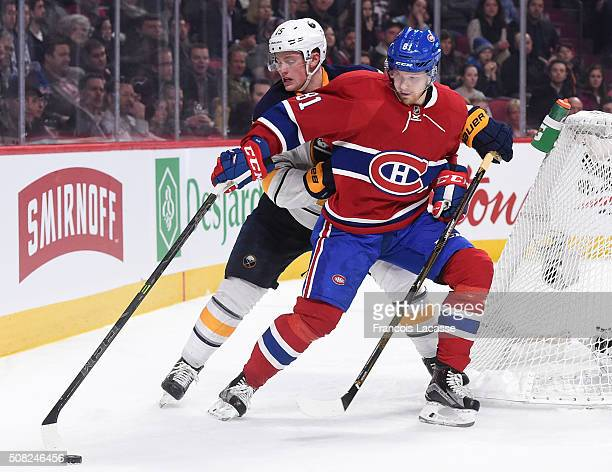 Lars Eller of the Montreal Canadiens controls the puck while being challenged by Jack Eichel of the Buffalo Sabres in the NHL game at the Bell Centre...