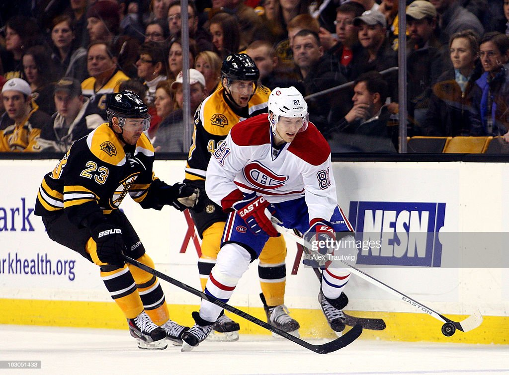 Lars Eller #81 of the Montreal Canadiens handles the puck as Chris Kelly #23 of the Boston Bruins defends during a game at the TD Garden on March 3, 2013 in Boston, Massachusetts.