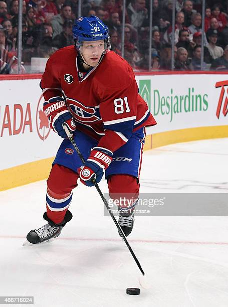Lars Eller of the Montreal Canadiens looks to pass the puck against the Ottawa Senators in the NHL game at the Bell Centre on March 12 2015 in...