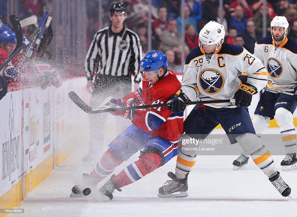 Lars Eller #81 of the Montreal Canadiens protects the puck against Jason Pominville #29 of the Buffalo Sabres during the NHL game on February 2, 2013 at the Bell Centre in Montreal, Quebec, Canada.