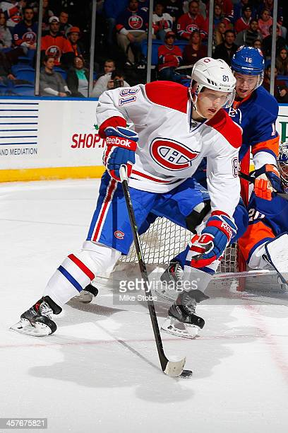 Lars Eller of the Montreal Canadiens skates against the New York Islanders at Nassau Veterans Memorial Coliseum on December 14, 2013 in Uniondale,...