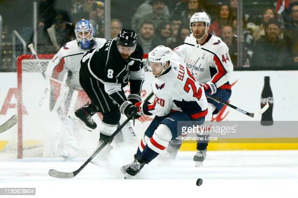 Lars Eller of the Washington Capitals and Drew Doughty of the Los Angeles Kings fight for control of the puck during the third period at Staples...