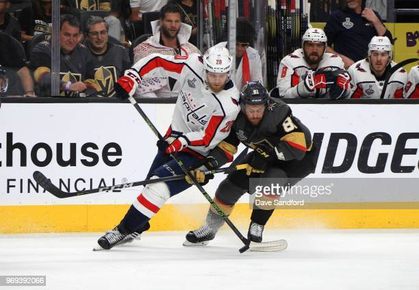 Lars Eller of the Washington Capitals and Jonathan Marchessault of the Vegas Golden Knights vie for the puck in the second period of Game Five of the...