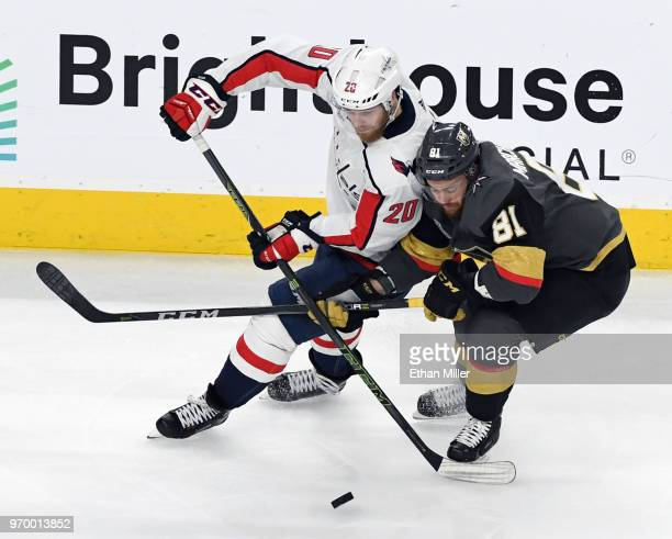 Lars Eller of the Washington Capitals and Jonathan Marchessault of the Vegas Golden Knights battle for the puck in the second period of Game Five of...