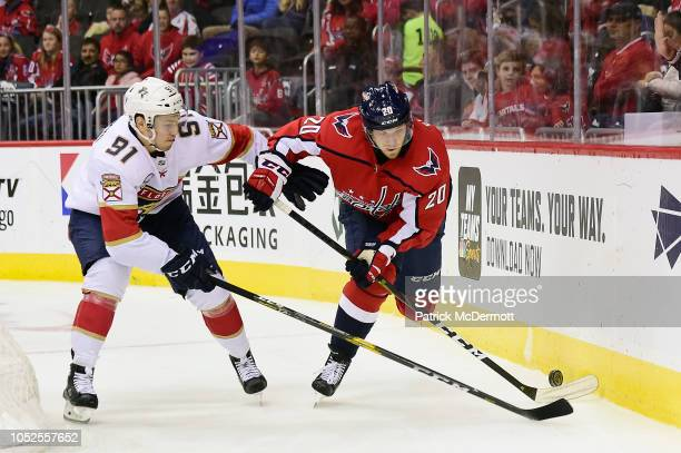 Lars Eller of the Washington Capitals and Juho Lammikko of the Florida Panthers battle for the puck in the second period at Capital One Arena on...